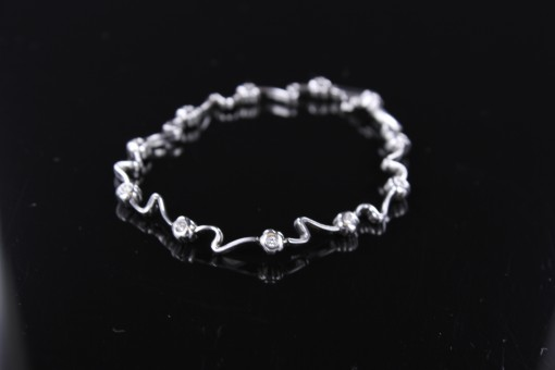 Wavy White Gold & Diamond Bracelet