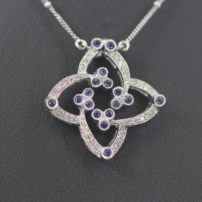 White gold diamond & Sapphire Cross Pendent